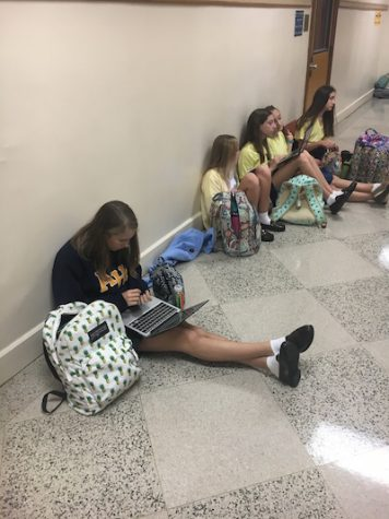 Freshmen take advantage of breaks during school to study in the hallways.