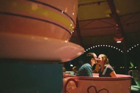 (Savannah Lauren/http://savannahlauren.com) After Ms. Mikos became a fiancė, her and Wynn adjourned to the teacup ride and watched the night parade.