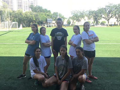 After a tough workout in the heat, the team strikes a serious pose.
