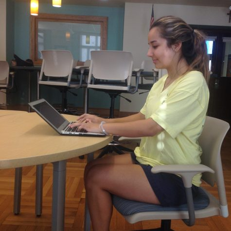 Junior, Françoise Corser, exhibits the proper posture while using her MacBook. Photo Credit: Sara Phillips/AchonaOnline