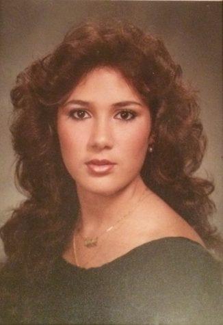 Alexis Alvarez's mother, Maria Alvarez, strikes a pose for her senior picture.