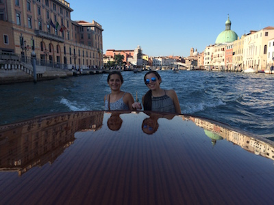 The Dingle twins travel through Venice on a vaporetto, a water taxi.