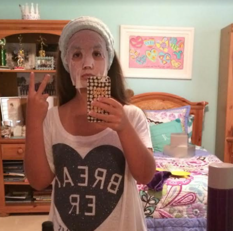 Senior Anna Padron sends off her best mirror selfie while prepping for Jesuit Homecoming, 2014.