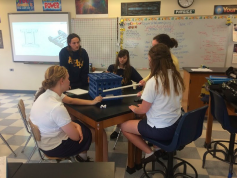Senior Sarah Tevlin and other Robotics club members are hard at work coming up with new ideas for their robots for this season. Photo Credit: Meredith Butler (used with permission)