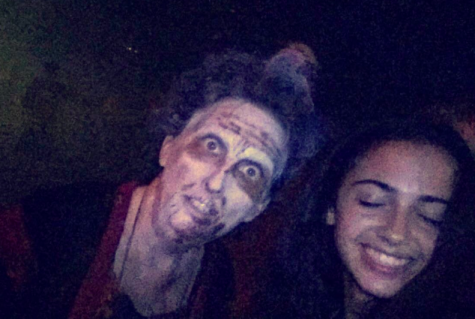 "Freshman, Grace Orama, takes a selfie with a zombie from a scare zone and posts it to her snapchat story. Orama states, ""This zombie was one of the only friendly creatures I encountered at the whole park."""