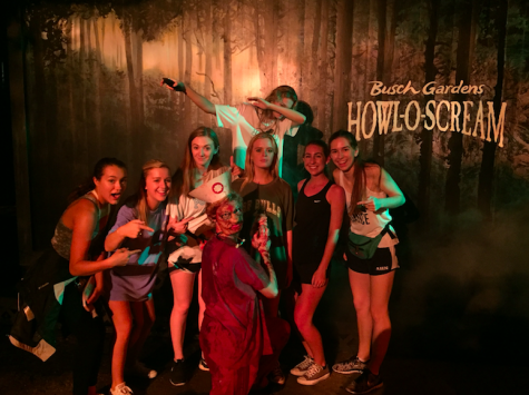 AHN Seniors pose with zombies at Howl-O-Scream in between scare zones.