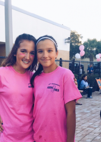 """Freshman Joely Barkett(left)pictured here with Cailin Cannella (right), an Academy seventh grader and swimmer, recently diagnosed with cancer. The swim and volleyball teams painted their nails yellow in honor of her. Coach Bill Shaffer has emphasized to his team, """"no one fights alone."""" #beatcancer"""