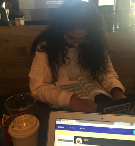 Neha Simon and Julia Lee work on A-Push homework at their designated study spot, DI Coffee Bar.