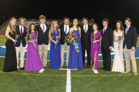 Credit: Devin Folkman/Achona Online The Homecoming Court smile together after the Queen, Devin Folkman, was crowned.