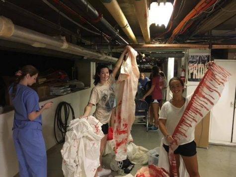 Council members Danielle Gutierrez, Maddie Oregon, and Anna Padron unload the decorations and begin to transform the basement. Photo Credit: Alex Smith/Achona Online
