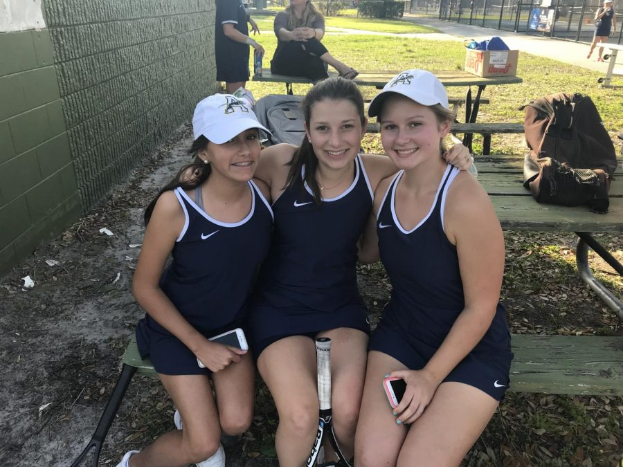Isabella+Duarte%2C+Katherine+Rodriguez%2C+and+Maddie+Chandler+rest+before+doubles+matches.+Photo+Credit%3A+Sara+Phillips%2FACHONAOnline