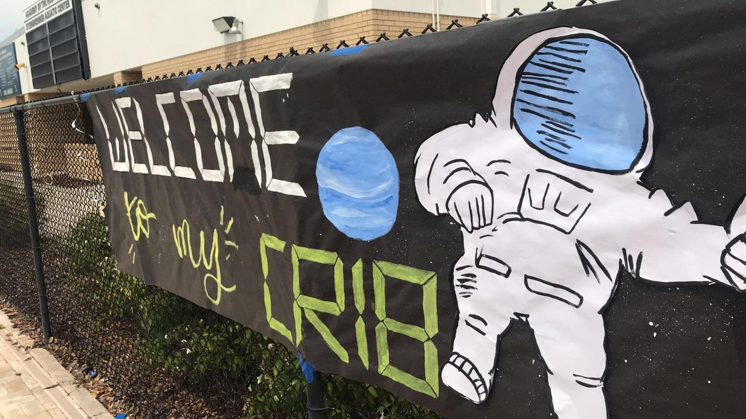 Katelyn Chau ('20) created a poster to go along with this years pool party theme, space. Photo Credit: Gretchen Swenson/ Achona Online