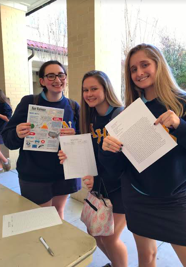 Photo credit: Katherine Rodriguez Group Madison Chandler ('19), Mckenzie Diaz ('19), Gabby Boyd ('19), and Juliana Ferrie ('19) asked people during lunch to sign a petition to fight for gun control in schools.